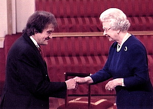Wilf receives his MVO from the Queen, August 2002